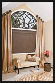 An arched window dressed in a beautiful angled panels, finished with a custom faux iron piece and a woven woods with silk window shade, gives this room a very romantic and luxurious look. Yes we do faux iron! Arched Window Treatments, Custom Window Treatments, Budget Blinds, Faux Wood Blinds, Window Dressings, Window Design, Foyers, Basement Remodeling, Basement Ideas