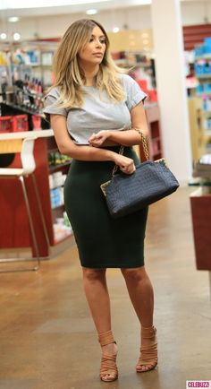 Kim K in cropped top & pencil skirt... Shows off all her KURVES!