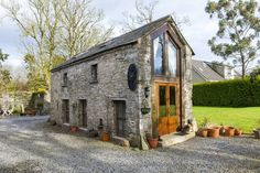 Cabin in Ardcath, Garristowm, Ireland. A Romantic Retreat -Tastefully converted stone barn with views of 13th C. Abbey ruins & mature garden. Ideal location for touring east coast and Dublin (Airport 30min). Mezzanine bedroom overlooking the open plan living area & wood burning stove. ...