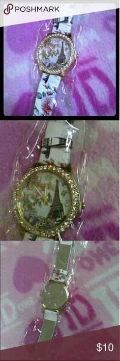 A beautiful quartz watch Hi ^.^  We have a very beautiful quartz beige watch, Eiffel Tower, Paris, France. Brand new.  Love to bundle Accessories Watches