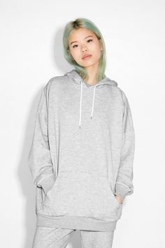 An oversize hoodie sweatshirt that vibes Brooklyn, NY circa '95. Note the hood's drawstring is threaded through two nifty silver eyelets. Ribbed around the bottom and at the wrists. Cotton-poly blend.  colour: palfrey grey In a size small the chest width is 132 cm and the length is 76 cm. The model is 175 cm and is wearing a size small.