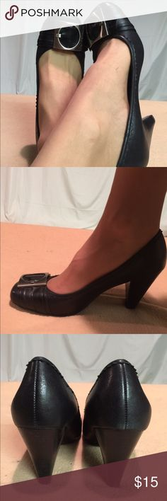 BCBGeneration Black Leather Big Buckle Pumps These shoes have been GENTLY WORN and have a lot of life left in them. The leather on the inside of the shoe is wearing but the outside is in perfect condition. The heel height is 3 inches tall. BCBGeneration Shoes Heels
