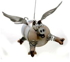 "Sugarpost Gnome Be Gone Mini Flying Pig Welded Metal Art  Approx size: 5""X4""X3""  There is a hook above the head to allow you to hang this item  Handcrafted from used metal parts  Made in the USA  Perfect for both Indoor Outdoor Use  Designed by..."
