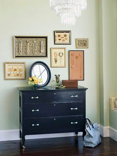 Creative Ways to Display Your Jewelry-   Eclectic frames that house pretty knobs come together to create a salon gallery display and make an artistic statement on the wall. (Note to self: arrange handmade jewelry to keep best pieces within easy reach and on display.)