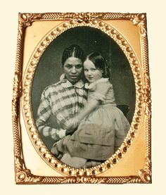 """The rare tintype of Baltimore slave Martha Ann """"Patty"""" Atavis and Alice Lee Whitridge, the young girl she cared for, was probably taken in 1860."""