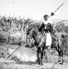 Bedouin warrior holding a spear / lance, late 1800s to early 1900s.