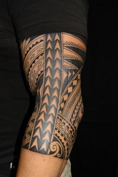 Tremendous Polynesian Tribal Tattoo On Arm For Guys