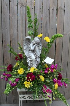 Angel in Fresh Flower Arrangement