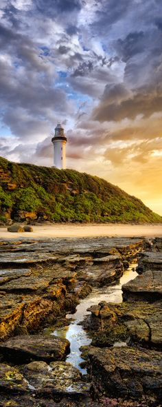 ~~Sentinel • golden light caresses the shore by the Nora Head Lighthouse, NSW, Australia • by Timothy Poulton~~