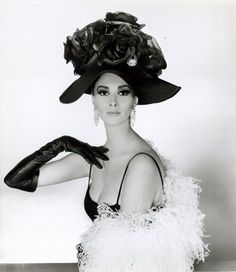 Wilhelmina is wearing a silk hat decorated with large silk roses, called L'Imperatrice, (The Empress) from Mr. John's 'Boldini' collection for autumn and winter 1964.     (can you imagine people wearing hats like these today? so lovely and extravagant!)