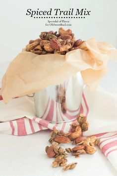 Spiced Trail Mix is loaded with crunchy almonds, cashews, pumpkin seeds and coconut flakes. Roasted with maple syrup and spices to create a delicious snack!