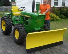 This started out as a old JD 430 and I transformed it into a mini 4020 .