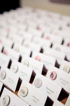 Buttons for escort cards - what a sweet keepsake  #escort cards