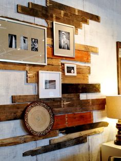 Totally Cool way to Display Art using old scrap wood or skid boards mounted on the wall..then hang the frames on it