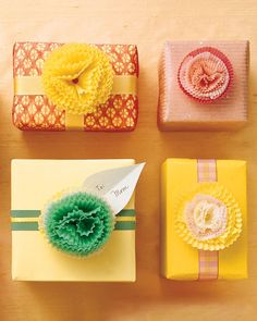 Baking liners make sweet gift toppers for Mother's Day, or anytime. Nesting pastel papers in different sizes -- petit four, mini muffin, and cupcake -- creates fluffy blooms that will add a flourish to beribboned presents. You'll find liners in the baking section of grocery stores and housewares stores. Combine a bunch, then secure with a brass fastener.
