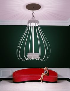 """#Dorothy_Draper A 9-foot-tall (2.7 m) white """"bird-cage"""" chandelier that Draper designed for the Metropolitan Museum of Art's Dorotheum cafe"""