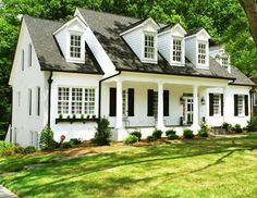 White brick ranch house, black shutters, black eaves troughs and mullions. I also love how the left side has a black planter garden box, but no shutters. Exterior House Colors, Exterior Paint, Exterior Design, Exterior Shutters, Diy Exterior, Style At Home, Cape Cod Exterior, White Brick Houses, Painted White Brick House
