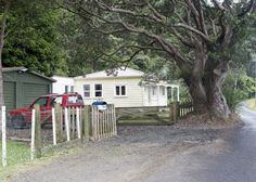 Barr Cottage, Huia - just across the road from Little Huia (Regional Parks bach) Nz History, Auckland, Regional, Parks, Shed, Cottage, Outdoor Structures, Sheds, Cottages