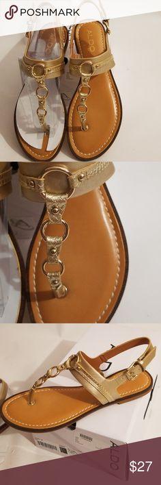 Aldo Sirang Gold Thong Sandal BORN Black Leather Thong Strap Flat Sandals Adorable Born Sandals Features: Thong Strap Black Leather Flowers Detail Ankle Strap SZ 7M Buckle Closure Pre-Own, Good Condition! Born Shoes Sandals
