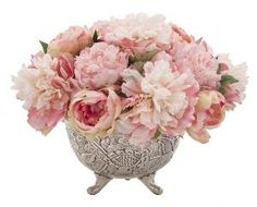 """The arrangement features lovely pink peonies in a silver beaded rim bowl.  Measures 15""""W X 12""""H.  Product in photo is from www.wellappointedhouse.com"""