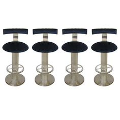 Set of Four Nicked-Plated Swivel Bar Stools by Designs for Leisure | From a unique collection of antique and modern stools at http://www.1stdibs.com/furniture/seating/stools/