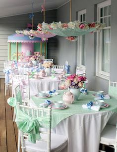 You don't just have to go black... setup a pastel Mary Poppins Tea Party! Love the flower accents on the umbrellas!