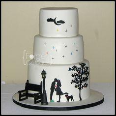 Silhouette couple wedding cake