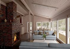Log house woth brick fireplace
