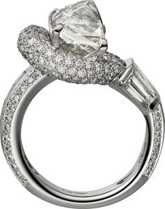 CARTIER. Ring - platinum, one 5.58-carat rectangular novelty-cut diamond, princess-cut diamonds, tapers diamonds, brilliant-cut diamonds. (=)