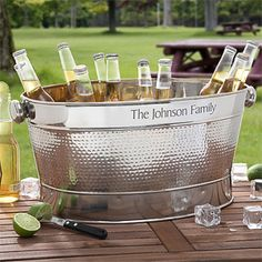 This Engraved Stainless Steel Outdoor Cooler Party Tub is perfect for outdoor summer parties! Personalize it with any family name or message and fill it with ice and your favorite drinks! It also looks great as a beach towel holder for the home pool!