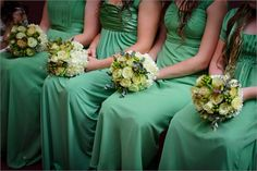 Green bridesmaids dresses with green and cream flowers