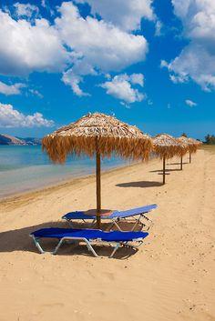 Beach  sunbeds on Agrostoli Bay near Lixouri, Kefalonia, Ionian Islands, Greece.