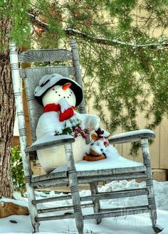 A snowman resting on a rocking chair and taking in some fresh snow. It's a cute idea for an outdoor Christmas decoration. Need more ideas? Check out my photo gallery of Christmas scenes: http://landscaping.about.com/od/galleryoflandscapephotos/ig/Christmas-Scene-Pictures/