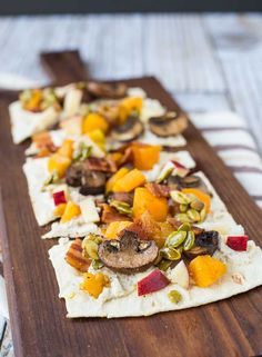 Experience a taste of fall with this ricotta flatbread! The party starts in the spiced ricotta and carries throughout the fun autumn toppings: bacon, squash, apples, mushrooms, and maple candied pepitas. You'll want to eat this all year! Get the easy recipe on RachelCooks.com! #sponsored @Flatout