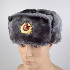 Soviet Russian Ushanka Hat - $46.99 This gray, man-made fur, Soviet Soldier's hat #Ushanka, was hand-crafted in Russia. It is designed to bring you the ultimate warmth. It can be worn with earflaps tied up on the top, or pulled down for extra comfort if it is cold outside. Quilted lining inside adds even more warmth to the hat. Hat comes with pin already attached. #winter #russian