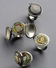 Polymer clay micromosaic rings by Cynthia Toops; metalwork by Chuck Domitrovich.