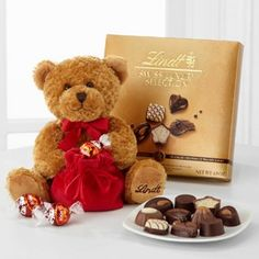The Lindt Loveable Holiday Bear is an adorable plush teddy bear and more! This soft teddy bear has a red bow around its neck and the Lindt logo embroidered on its right foot, and arrives with a 14-piece box of Lindt Swiss Luxury Chocolate.