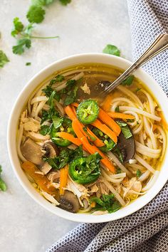 This Slow Cooker Asian Chicken Noodle Soup puts a twist on the classic. With a flavorful broth, mushrooms, ginger, garlic and noodles! | www.countrysidecravings.com