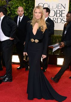 Kate Hudson is high drama in a sultry, fitted McQueen gown.