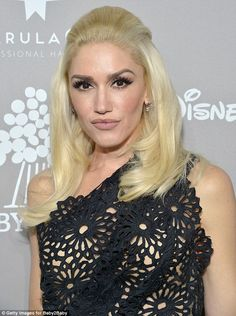 Stunning: Gwen, 46, rocked a one-shoulder, doily-inspired black frock with an asymmetrical nude underlay