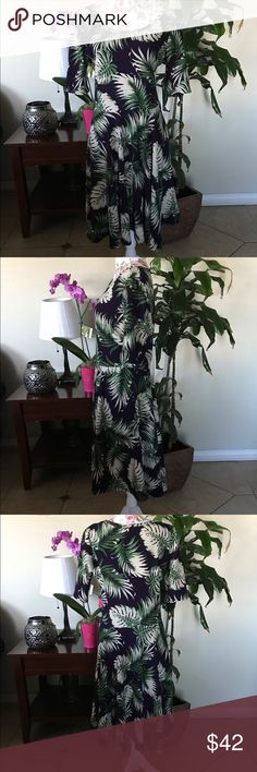 LuLaroe Dress Background color is eggplant, palm tree leaves, super summery playful dress, no rips no stains. Excellent condition LuLaRoe Dresses Midi
