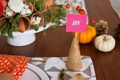 Some quick (and cute!) ideas for a Thanksgiving table...like an ice cream cone instead of the traditional cornucopia!