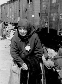 Germany. A jewish old woman standing on the platform, Birkenau Concentration Camp, 1944...These always break my heart.
