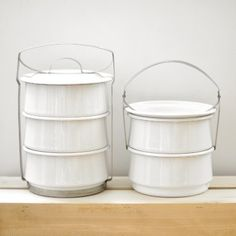 White enamel picnic containers ~ remind me of the Picnic Packs I have from the 50's.