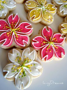 Cherry Blossom Cookies These are some Cherry Blossom cookies i did for my husbands work a few weeks back, they were inspired by some beautiful ones that Yukiko @ Rosey Sugar makes. www.flickr.com/photos/rosey_sugar_palace/3482120247 She makes it look so easy and her piping is so fine and flawless so im not sure when i'll be doing these again ! lol Thanks Yukiko =)