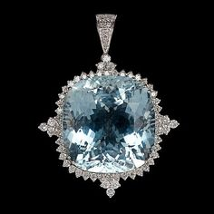 A large aquamarine and brilliant cut diamond pendnat mounted in 18k white gold