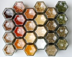 Magnetic spice rack kit with hand-stamped glass jars.