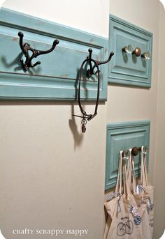 check out this coat hanger i made out of old cabinet doors, repurposing upcycling, this is the final product I love the color and the use of vintage door knobs as hooks