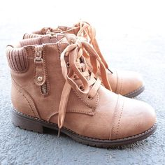 These boots feature a faux leather upper with a lace-up front and man-made sole. imported Heel height/type: 1-inch Platform height: 0.25-inch Shaft height: 4.75