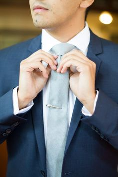 Classic navy blue and dusty blue groom style.